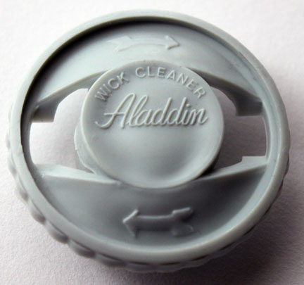 Early plastic Aladdin wick cleaner